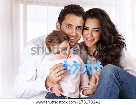 Portrait of sweet little child with mother and father at home, kid safety, people protection, creative education concept - stock photo