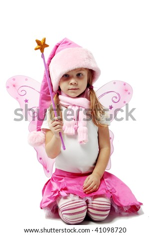 Portrait of sweet little girl in Christmas fairy costume