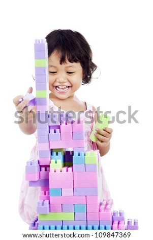 Portrait of sweet little girl with toy blocks. shot in studio isolated on white - stock photo
