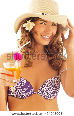 Portrait of tanned pretty young woman wearing hat and bikini clothes drinking fresh juice from glass with tubule. Isolated on white background with copyspace - stock photo