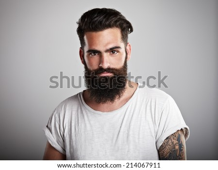 Portrait of tattooed bearded man - stock photo