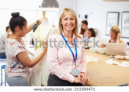 Portrait Of Teacher Helping College Fashion Students - stock photo