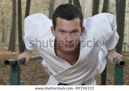 Portrait of teacher training in karate in nature - stock photo