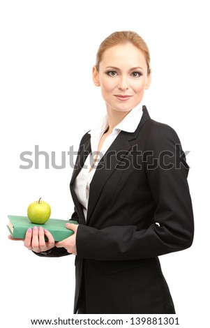 Portrait of teacher woman with book and apple, isolated on white - stock photo