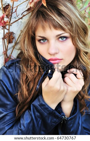 portrait of teen girl wering leather jacket - stock photo