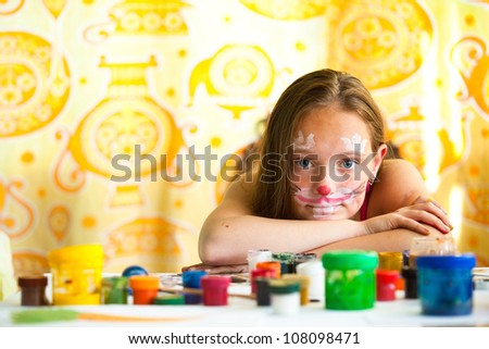 Portrait of teen-girl with paint of face. - stock photo