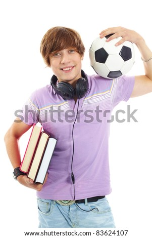 Portrait of teenage boy with books, headphones and ball looking at camera