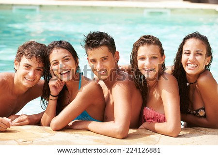 Portrait Of Teenage Friends Having Fun In Swimming Pool - stock photo