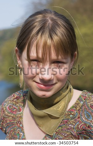 Portrait of teenage girl at sunset - stock photo