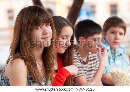 Portrait of teenage girl having fun outdoor with her friends on beautiful spring day. - stock photo