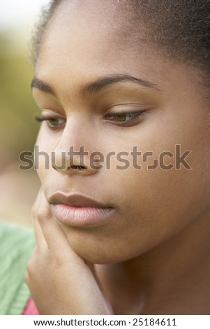 Portrait Of Teenage Girl Looking Upset - stock photo