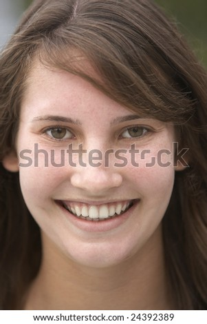 Portrait Of Teenage Girl Smiling - stock photo