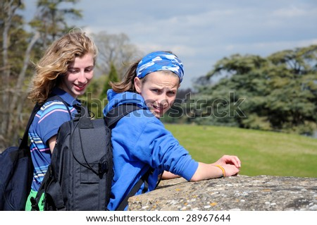 portrait of teenage girls backpacking - stock photo