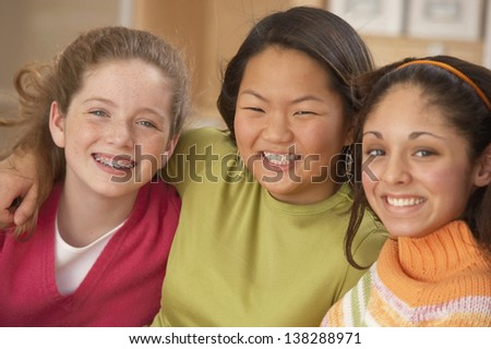 Portrait of teenage girls smiling