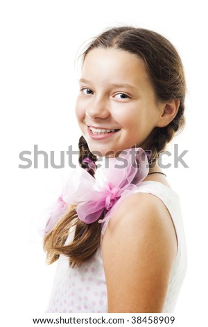 Portrait of teenager girl smile and look at camera in pink,isolated on white - stock photo