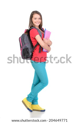 Portrait of teenager girl with school backpack holding colored folders isolated on white background - stock photo