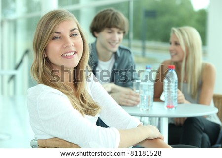 portrait of teenagers at table - stock photo
