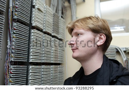 Portrait of telecom engineer on the digital distribution frame background - stock photo