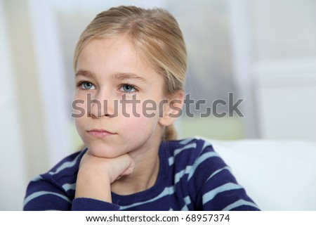 Portrait of ten-year-old blond girl - stock photo