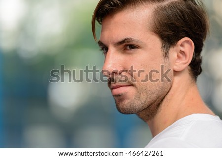 Portrait of tennis player outdoors
