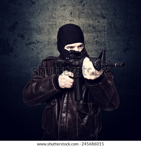 portrait of terrorist and grunge background - stock photo