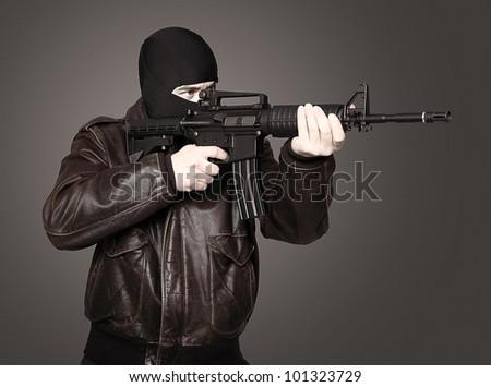 portrait of terrorist with automatic rifle - stock photo