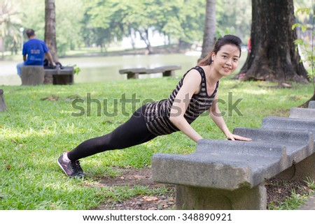 Portrait of thai adult beautiful girl doing yoga exercises in the park