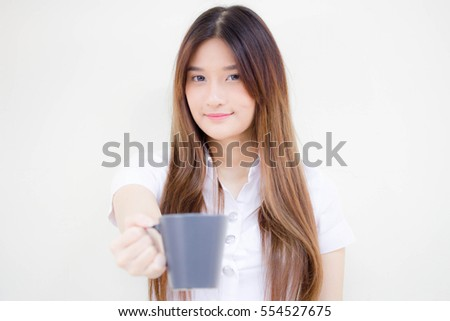 Portrait of thai adult beautiful girl drinking coffee