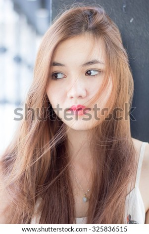 Portrait of thai adult beautiful girl relax time.