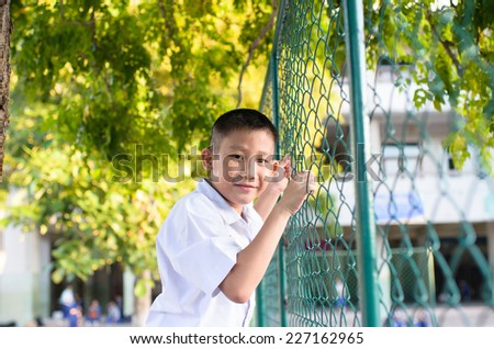 Portrait of Thai school boy in uniform. - stock photo