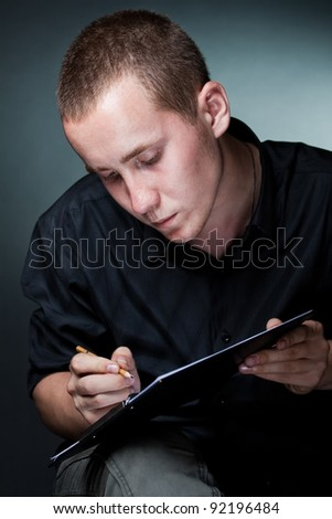 Portrait of the artist painting enthusiast, on a dark background