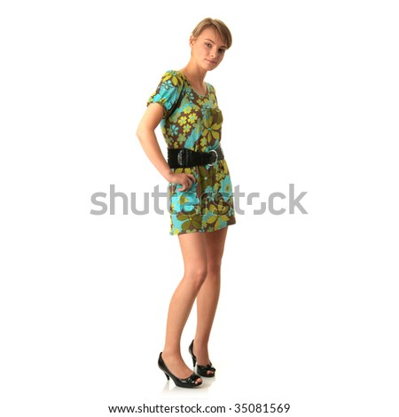 Portrait of the attractive blonde in green summer dress isolated on white background - stock photo