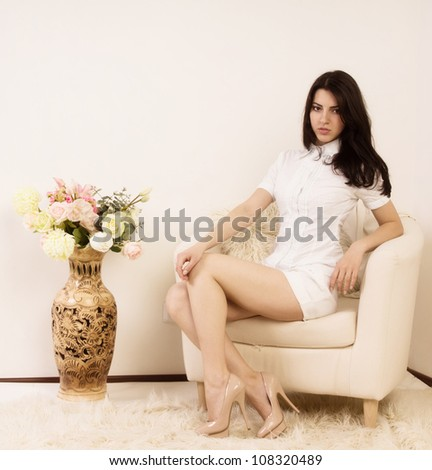 Portrait of the attractive brunette in a boudoir