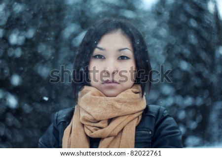 Portrait of the attractive girl on a neck a scarf