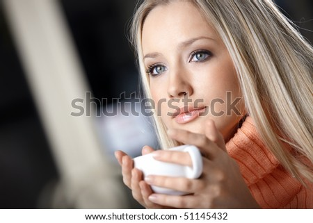 Portrait of the attractive girl with a cup - stock photo