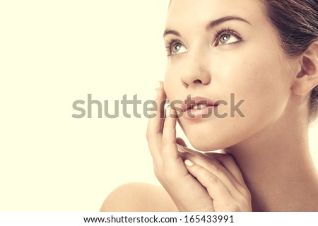 Portrait of the attractive girl without a make-up, isolated - stock photo