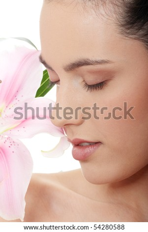 Portrait of the attractive girl without a make-up, with lily flower in hand, isolated on white background - stock photo