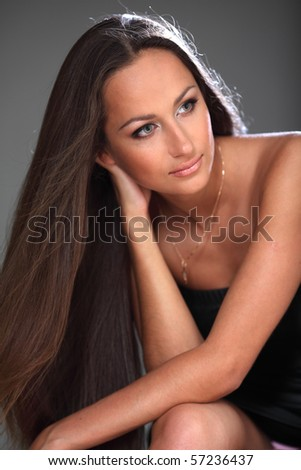 Portrait of  the attractive young brunette - stock photo