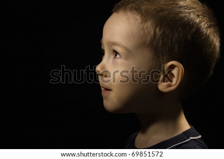 Portrait of the baby face on a black - stock photo