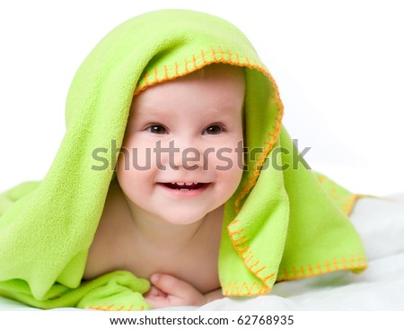 Portrait of the baby in a towel after bathing, isolated on a white background