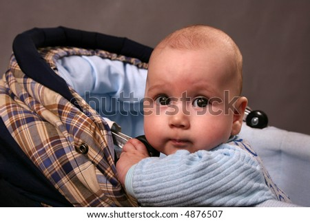 Portrait of the baby who is being a carriage - stock photo