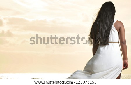 Portrait of the back of an  African American woman walking - stock photo