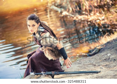 Portrait of the beautiful Amazons by the lake - stock photo
