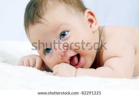 Portrait of the beautiful baby - stock photo