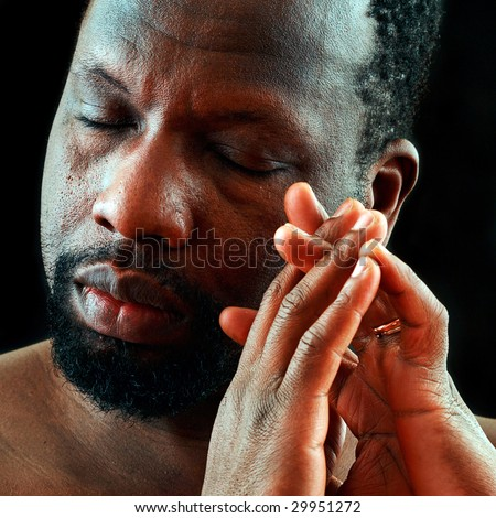 Portrait of the beautiful black man with an impressive skin - stock photo