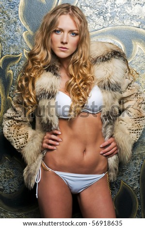 Portrait of the beautiful blonde in fur jacket - stock photo