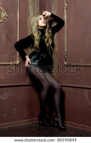 Portrait of the beautiful blonde in interior - stock photo