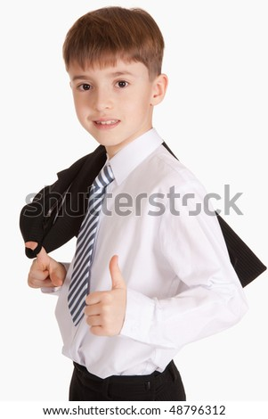 Portrait of the beautiful child in a suit, giving greater fingers upward.