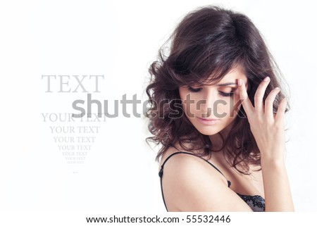Portrait of the beautiful elegant girl with curly hair - stock photo