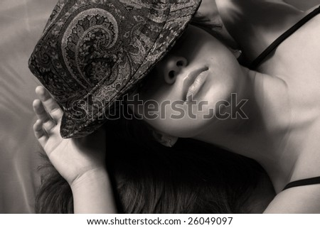 Portrait of the beautiful girl a hat covering the person.